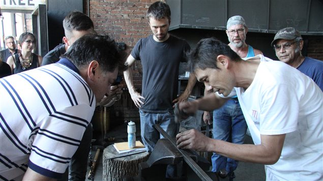 Master Japanese swordsmith Fusataro shows students at a recent blade-making workshop at Les Forges de Montreal how to sign their work with a chisel.