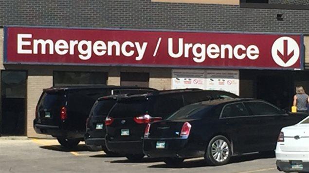 The former president's motorcade is seen parked outside of St. Boniface General Hospital in Winnipeg.