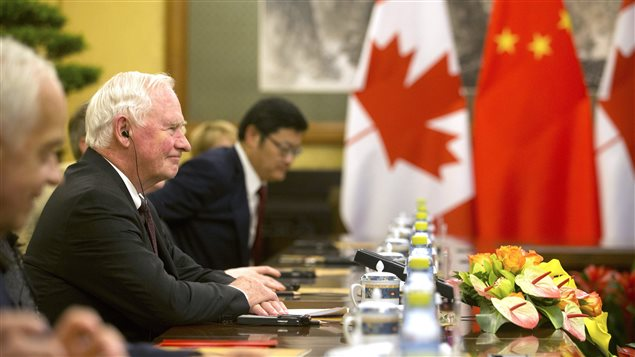 Governor General of Canada David Johnston, second from left, sits during a meeting with Chinese President Xi Jinping at the Diaoyutai State Guesthouse in Beijing, Thursday, July 13, 2017.