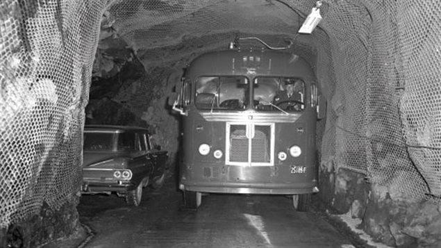 The tunnels only allowed one vehicle at a time, so any car would have to pull into a cubby hole to allow the bus to pass.