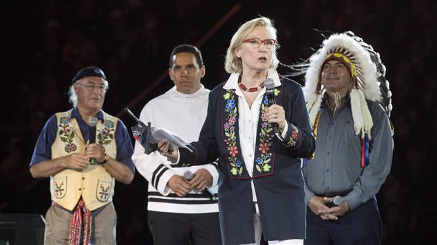 Canada's Minister of Indigenous and Northern Affairs Carolyn Bennett speaks as President Clement Chartier of the Metis Nation, left to right, President Natan Obed of the Inuit Tapiriit Kanatami and National Chief of the Assembly of First Nations Perry Bellegarde look on during the opening ceremony of the 2017 North American Indigenous Games, in Toronto on Sunday, July 16, 2017.