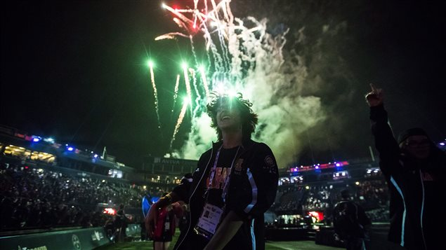 An athlete from Manitoba celebrates as fireworks go off during the opening ceremony of the 2017 North American Indigenous Games, in Toronto on Sunday, July 16, 2017.