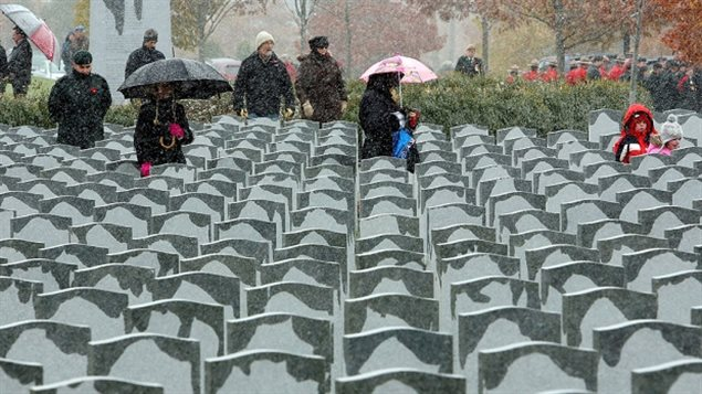A light rain dampens the tops of grave markers at the Beechwood Military Cemetery in Ottawa. A audit of 207,000 veterans' graves across Canada revealed that more than 45,000 require maintenance, needing some 60,000 repairs.