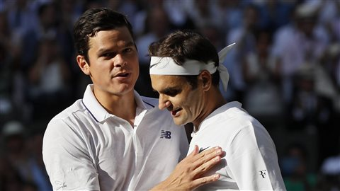 Roger Federer, right, greets Canada's top player, Milos Raonic, after Federer's quarter-final victory last week at Wimbledon. Canadians are hoping that Raonic,who defeated Federer in the 2016 Wimbledon semis, gets another shot in Montreal at the Rogers Cup.