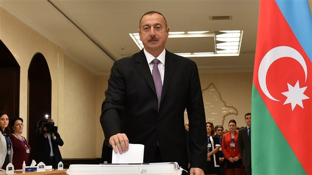 Azerbaijan's President Ilham Aliyev casts his vote during a referendum on extending presidential terms in Baku, Azerbaijan, September 26, 2016.