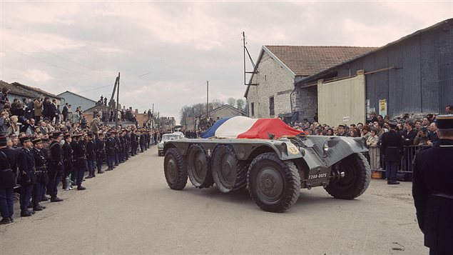 Crowds lined up on the street watch as the tricolor covered coffin of former French President General Charles de Gaulle (1890-1970) is carried on an armoured vehicle to the cemetery of Colombey-les-Deux-Eglises in Haute-Marne, France, November 12, 1970. It took Canadian officials several drafts to come up with an official letter of condolences, says former Canadian diplomat Ferry de Kerchove.