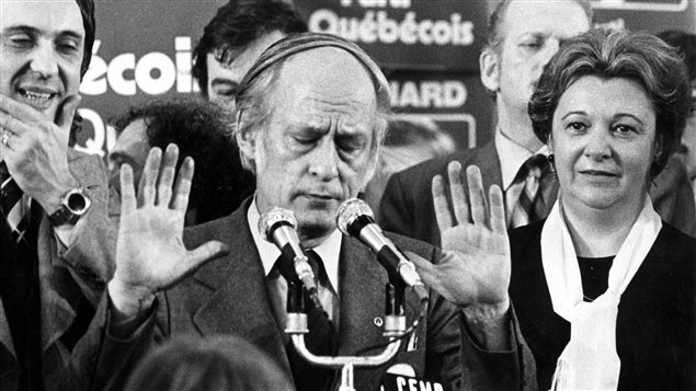 FILE--Quebec Premier Rene Levesque tries to hush supporters at a Parti Quebecois rally in Montreal, Nov.15, 1976, following his party's victory over the Liberal party of Robert Bourassa in the provincial election.