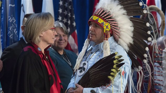 Assembly of First Nations Chief Perry Bellegarde speaks with Indigenous and Northern Affairs Minister Carolyn Bennett before the start of the Assembly of First Nations Special Chiefs assembly in Gatineau, Quebec on Tuesday December 6, 2016.