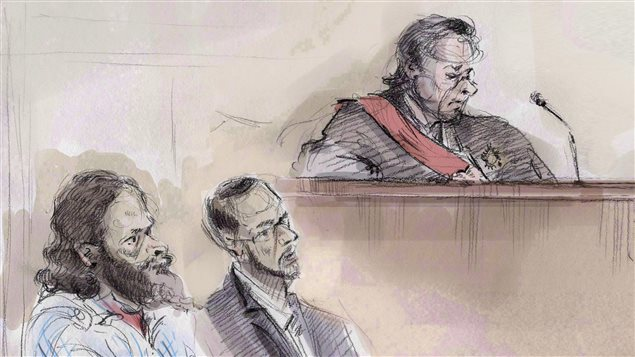 In an artist's sketch, Chiheb Esseghaier (left) and Raed Jaser (centre) appear in court in Toronto on Thursday, March 5, 2015 as Justice Michael Code looks on. Two men found guilty of terrorism charges after being accused of plotting to derail a passenger train have been sentenced to life in prison.