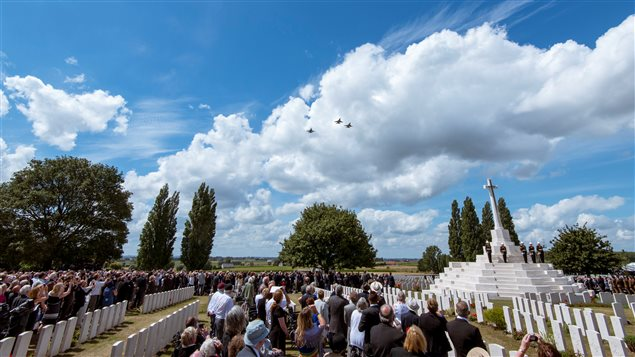 Jets fly over commemorations for the 100th anniversary of the battle of Passchendaele at Tyne Cot cemetery near Ypres in Belgium, July 31, 2017.