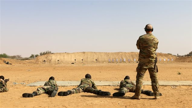 A member of Canadian Special Operations Forces Command coaches members of the Niger Armed Forces on marksmanship during Flintlock 2017 in Diffa, Niger, March. 2, 2017. Flintlock is a special operations forces exercise designed to hone the capabilities of U.S. and partner nation military units in Trans-Saharan Africa. (U.S. Army photo by Staff Sgt. Kulani Lakanaria)