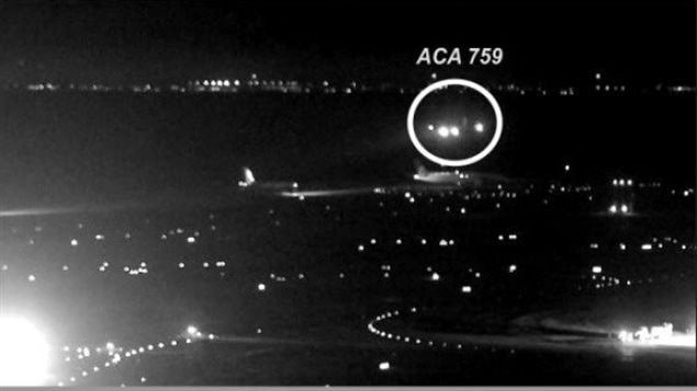 The National Transportation Safety Board has released photos taken from San Francisco International Airport video showing the July 7 *near miss* when Air Canada Flight 759 came close to landing on a taxiway with four airplanes on it instead of on the runway. (National Transportation Safety Board )