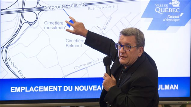 Mayor Regis Labeaume shows a map of where the Muslim cemetery will be established in Quebec City.
