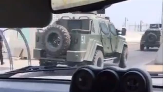 A still image from a video posted on Twitter on Aug. 5, 2017, shows a column of Canadian-produced Terradyne Gurkha APC operated by Saudi Special Security Forces in the besieged city of Awamiyah in Saudi Arabia's Eastern Province.