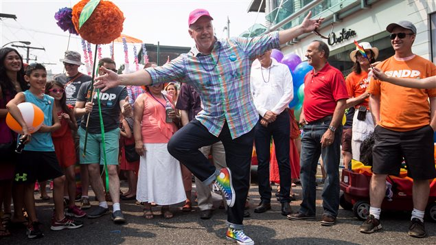 British Columbia Premier John Horgan cavorted in rainbow sneakers before joining the parade.