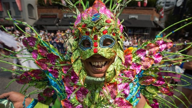 Some revelers wore elaborate masks and costumes to the Vancouver Pride Parade.