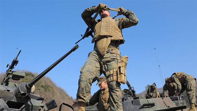 A US marine carries a M-4 rifle on a LAV-25 light armored vehicle during the CQB (Close Quarters Battle) drill at the US army's Rodriguez range in Pocheon, about 70 km northeast of Seoul near the heavily-fortified border with North Korea on March 1, 2008.