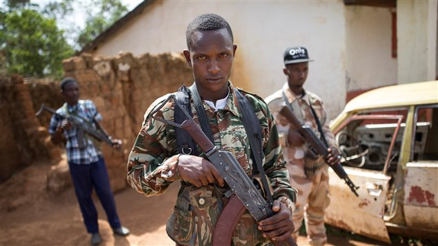 Armed fighters belonging to the 3R armed militia stands guard while their leader General Sadiki is talking to the media in the town of Koui, Central African Republic, April 27, 2017.