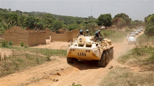 United Nations peacekeeping force vehicles drive by houses destroyed by violence in September, in the abandoned village of Yade, Central African Republic April 27, 2017.