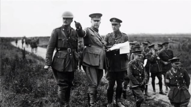 LGen Arthur Currie (centre). As he had done before Currie went to the area to get a first hand analysis, and determined the British plan to attack Lens would be a disaster, instead he insisted on caputring the high ground nearby at Loos, a strategic advantage.