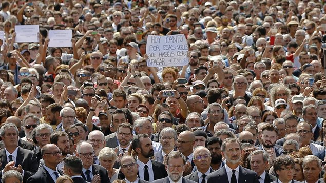 Signs read 'we are not afraid' and spoke for thousands who joined the king of Spain's king and the mayor of Barcelona (foreground) after the terrorist attack in that city.