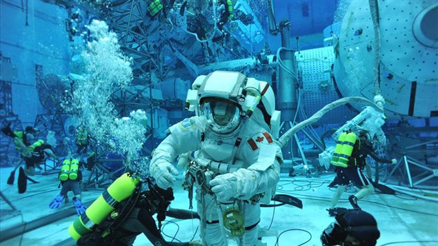 Part of the astronaut school training includes preparation for spacewalks. Here CSA Astronaut David Saint-Jacques during his first spacewalk training at NASA's Neutral Buoyancy Laboratory (NBL) in Houston, Texas.