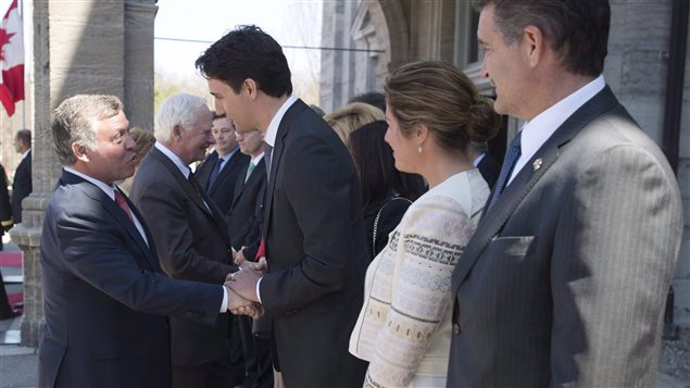 Jordan's King Abdullah II speaks with then Liberal Leader Justin Trudeau as his wife Sophie Gregoire and Canada's Ambassador to Jordan Bruno Saccomani look on during an official weleome to Rideau Hall Wednesday April 29, 2015 in Ottawa.