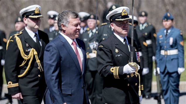 King Abdullah II of Jordan inspects the honour guard at Rideau Hall in Ottawa on Wednesday, April 29, 2015. He is expected to visit Canada again from Aug. 27 to 29, 2017.