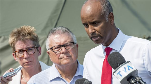 Immigration Minister Ahmed Hussen, right, and Public Safety Minister Ralph Goodale addressed the influx of asylum seekers at a Canada-U.S. border crossing on August 21, 2017.