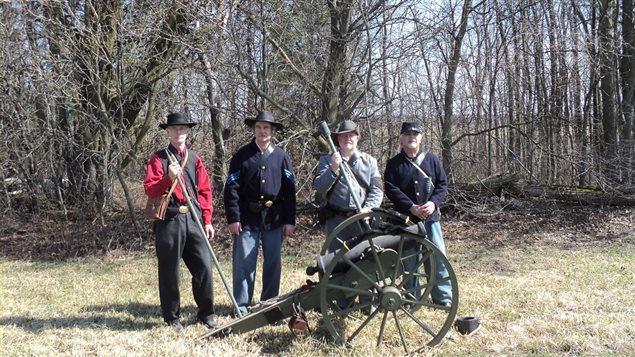 Members of the Grays and Blues of Montreal with replica short-barrel mountain howitzer during an event in Ontario in 2013