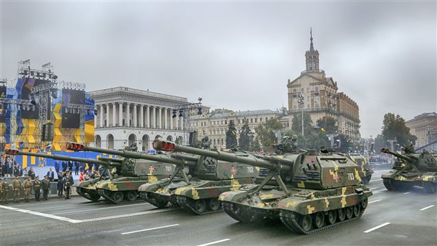 Self-propelled howitzers ride along Khreshchatyk Street during a military parade to mark the 25th anniversary of Ukraine's Independence, in the capital Kiev, Ukraine, Wednesday, Aug. 24, 2016.