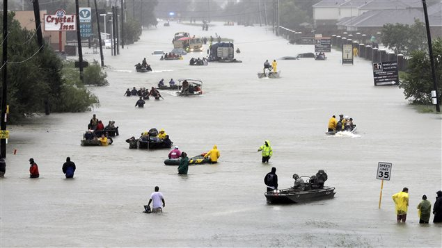 Rescue boats help flood victims evacuate their homes in Houston, U.S.