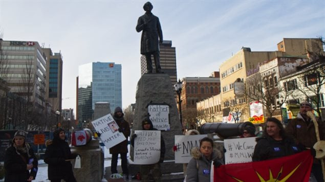 About a dozen aboriginal rights advocates staged a protest in front of Sir John A. Macdonald's statue in Hamilton in January 2015, the politician's 200th birthday.