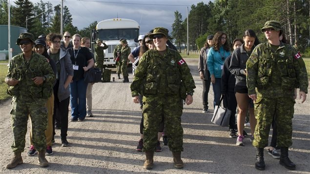 These women arrive at the Canadian Forces Base and line up by Military personnel for their 10-day experience as *soldiers*. Theywere curious about careers in the Canadian Forces and felt this would give them a sense of that life before committing to join.