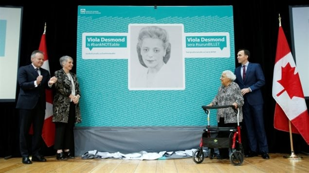 Dec 8/2016 Federal Finance Minister Bill Morneau (far right) stands with Viola Desmond's sister Wanda at a ceremony at the Canadian Museum of History, in Gatineau, Que., announcing the new $10 bank note that will feature Viola's image