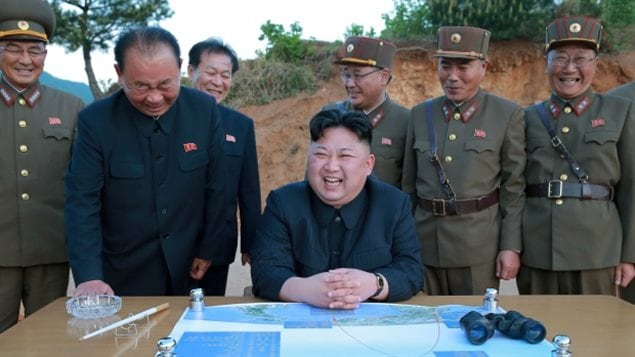North Korean leader Kim Jong-un, shares a laugh during a recent test of a long-range strategic ballistic rocket in this photo released by North Korea's Korean Central News Agency (KCNA). Experts say North Korea might be preparing more provocative weapons tests.