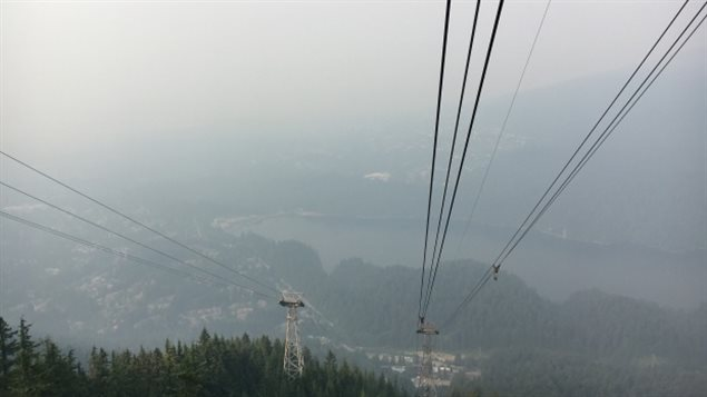 Smoke covers the city of Vancouver as seen from Grouse Mountain.