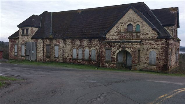 The derelict Commercial Cable Building in 2013. Although it looks solid, engineers were concerned at the time, and this summer declared in unsafe and not restorable.