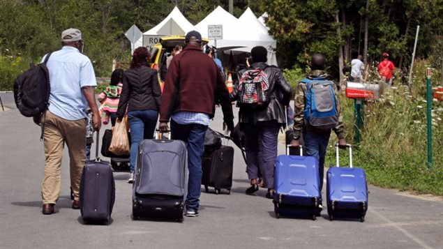 About 7,000 Haitians fearing the end of a protection policy in the U.S that could have seen them deported, decided instead to cross illegally into Canada this summer and claim refugee asylum. A temporary tent has been erected at the illegal crossing point to process them.