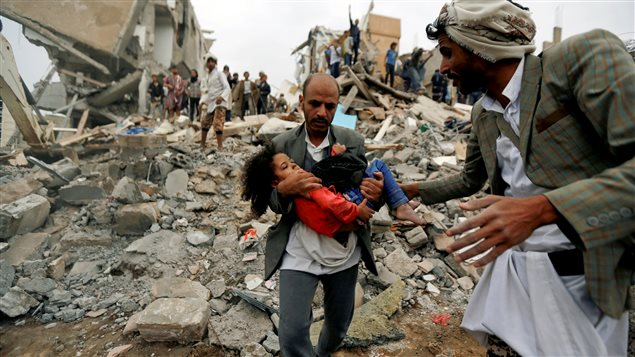 A man carries Buthaina Muhammad Mansour, believed to be four or five, rescued from the site of a Saudi-led air strike that killed eight of her family members in Sanaa, Yemen August 25, 2017.