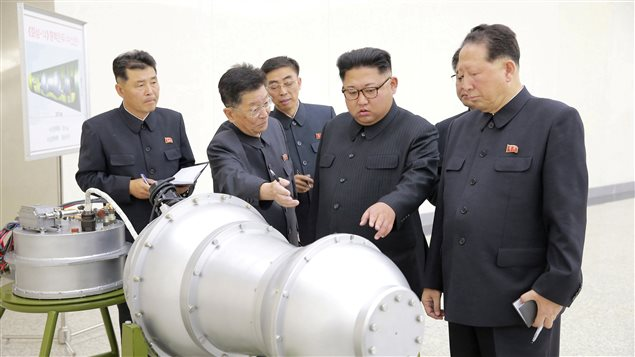North Korean leader Kim Jong Un provides guidance with Ri Hong Sop (2nd L) and Hong Sung Mu (R) on a nuclear weapons program in this undated photo released by North Korea's Korean Central News Agency (KCNA) in Pyongyang September 3, 2017.