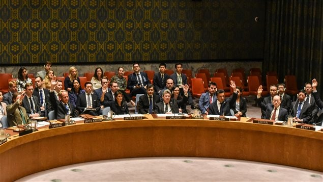 Ambassadors to the UN vote during a United Nations Security Council meeting on North Korea in New York City, U.S., September 11, 2017.