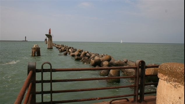 The east mole at Dunkirk 2009. One can walk to the end of the concrete jetty or mole but the wooden jetty was destroyed by a strom in the 1970's.