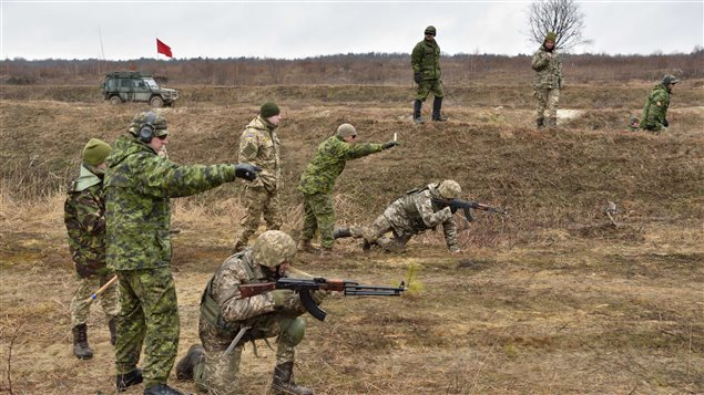 Canadian instructors of Joint Task Force - Ukraine provide guidance and safety support to Ukrainian soldiers during section attack practice as part of small team training, at the International Peacekeeping and Security Centre in Starychi, Ukraine, on March 3, 2017.