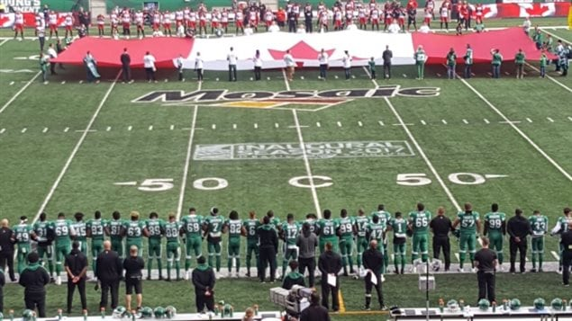 Anti-Trump protests by NFL players in the U.S, has spread to Canada with Saskatchewan Roughriders linking arms this weekend during the Canadian anthem in solidarity with NFL protesters south of the border.