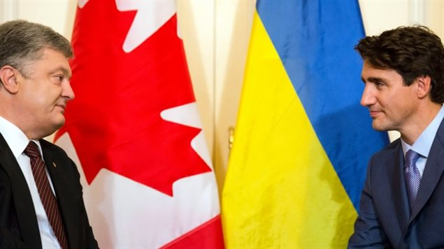 Prime Minister Justin Trudeau met with Ukrainian President Petro Poroshenko in Toronto Friday. Trudeau said he supported the notion of a UN peacekeeping mission to Ukraine, but stopped short of pledging to take part. Ukraine may soon be able to purchase Canadian weapons however.