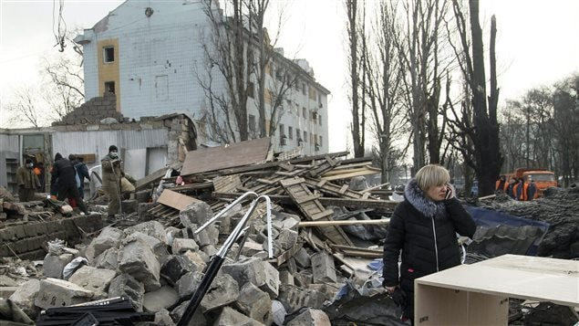 A woman speaks on her cell phone amonst the ruins of a building after shelling in Donetsk, eastern Ukraine, Friday, Feb. 3, 2017. Heavy shelling hit both government- and rebel-controlled areas.  Low level fighting continues in some areas of Ukraine, like Donbass, between Urkrainian forces and Russian-backed insurgents