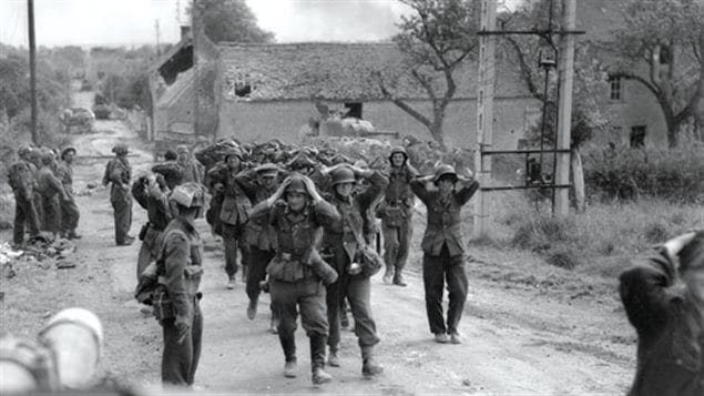 Another group of Germans surrender to Currie''s small force and walk out of St Lambert
