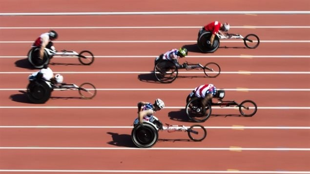 Athletes compete in the men's 100-metre dash IT5 wheelchair race on Sunday.
