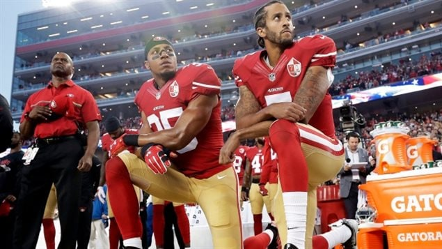 San Francisco 49ers quarterback Colin Kaepernick (7) and safety Eric Reid (35) and kneel during the national anthem in 2016 in a protest against police brutality. Kaepernick is now unemployed, a fact that hasn't escaped the Canadian Football League Montreal Alouettes.